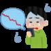 投資で下落するチャートを見る男性(いらすとや)